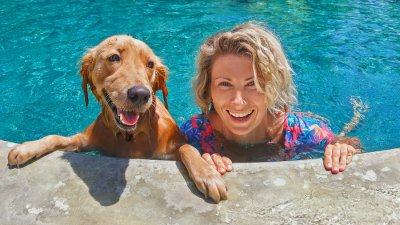 women and dog in pool